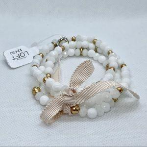 3 White Beaded Stretch Bracelet With Jeweled Charm